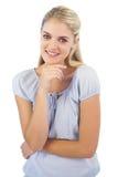 Cheerful blonde woman looking at camera Royalty Free Stock Photography