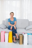 Cheerful blonde woman with shopping bags Royalty Free Stock Image