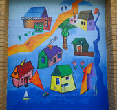 Cheerful blue houses mural painted by children Royalty Free Stock Images