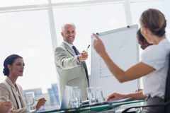 Cheerful boss pointing at a colleague Royalty Free Stock Images