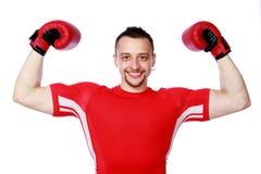 Cheerful boxer man winner raising arms Stock Photos