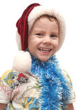 The cheerful boy. In a New Year's cap Royalty Free Stock Image