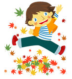 Cheerful boy with autumn leaves Stock Photo