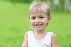 Cheerful boy on a background of green Stock Images
