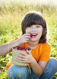 Cheerful boy with a basket of berries Royalty Free Stock Photo