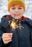 Cheerful boy with Bengal fire in hand in winter Royalty Free Stock Photography