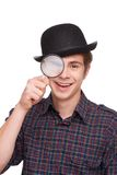 Cheerful boy in black hat with loupe Royalty Free Stock Photography