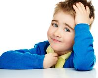 Cheerful boy in blue cardigan. Cheerful little boy in blue cardigan and yellow shirt Royalty Free Stock Photography