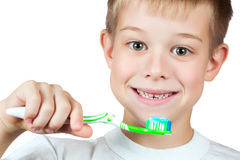 Cheerful boy is brushing his teeth Royalty Free Stock Photo