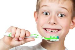 Cheerful boy is brushing his teeth isolated Stock Photos