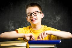 Cheerful boy with bunch of books. Education abstract Stock Photography