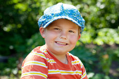 Cheerful boy in a cap Royalty Free Stock Images