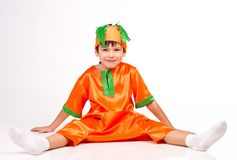 Cheerful boy in carrot fancy dress Stock Images