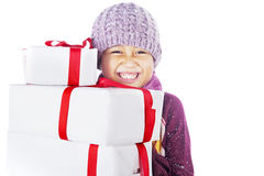 Cheerful boy and Christmas gifts isolated in white Stock Photography