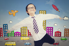 Cheerful boy with city background Royalty Free Stock Photography