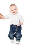 Cheerful boy in clothes makes first steps Royalty Free Stock Photos