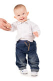 Cheerful boy in clothes makes first steps Royalty Free Stock Images