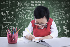 Cheerful boy drawing in class Royalty Free Stock Images