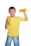 Cheerful boy with dumbbells Royalty Free Stock Images
