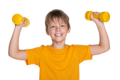Cheerful boy with dumbbells do exercises Royalty Free Stock Photo