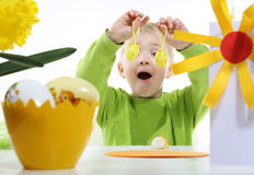 Cheerful boy and  Easter eggs Royalty Free Stock Image