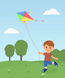 Cheerful boy enjoying flying kite Stock Photos