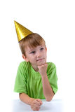 Cheerful boy in a festive hat Royalty Free Stock Photos