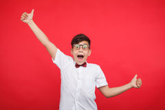 Cheerful boy gesturing on red Royalty Free Stock Image