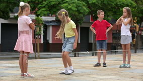 Cheerful boy and girls having fun with chinese jumping rope. Cheerful boy and girls in elementary school age having fun with chinese jumping rope stock video