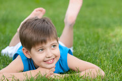 Cheerful boy on the green lawn Stock Photo