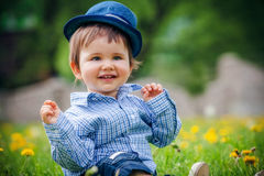 Cheerful boy with hat in summer park Stock Photo