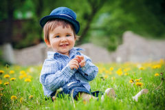Cheerful boy with hat in summer park Royalty Free Stock Photography