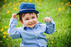 Cheerful boy with hat in summer park Royalty Free Stock Images