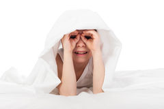 Cheerful boy hiding under blanket Stock Photography