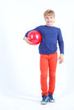 Cheerful boy holding the ball Stock Photos