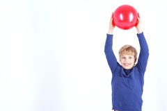 Cheerful boy holding the ball Royalty Free Stock Images