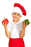 Cheerful boy holding bell peppers. Cheerful little boy holding bell peppers isolated on white background Stock Photography