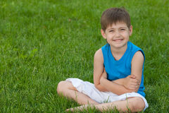 Cheerful boy on the lawn royalty free stock images