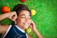 Cheerful boy listening to music Stock Images