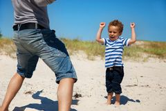 Cheerful Boy Looking Excited Together with Dad Stock Images