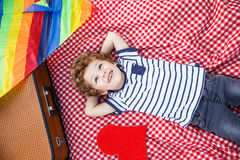 Cheerful boy lying on blanket Stock Images