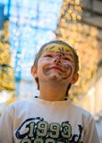 Cheerful boy with makeup on his face Royalty Free Stock Photos