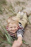 Cheerful boy playing on the beach. Beautiful boy playing on the beach. Oudoor portrait Royalty Free Stock Photo
