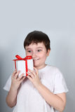 Cheerful boy with present Stock Photo