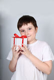 Cheerful boy with present Stock Images