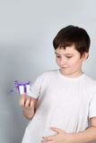 Cheerful boy with present Royalty Free Stock Image