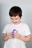 Cheerful boy with present Stock Photos