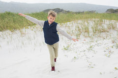Cheerful boy running at beach Royalty Free Stock Photos