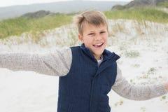 Cheerful boy running at beach Stock Photo