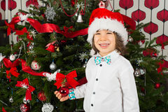 Cheerful boy with santa hat Royalty Free Stock Images